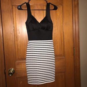 Black and white striped body con dress.
